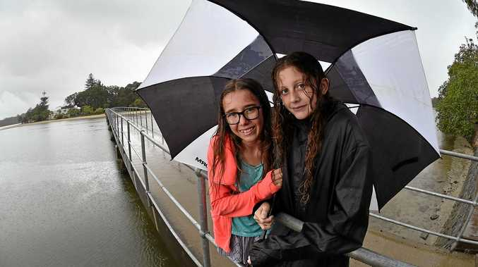 WEATHER: Out making most of a wet Saturday are Montana Bishop and Mia Yule at Chambers Island.