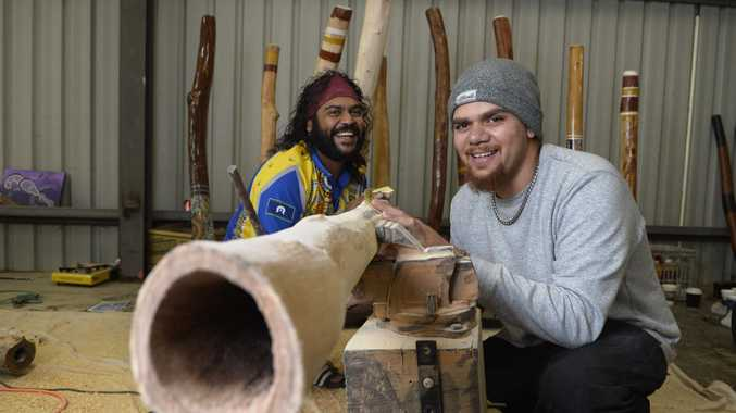 David McCarthy (left) and William Haupt of Ulidi Dreaming show the process of making a didgeridoo at Cully Fest 2017 at Toowoomba Showgrounds, Saturday, November 18, 2017.