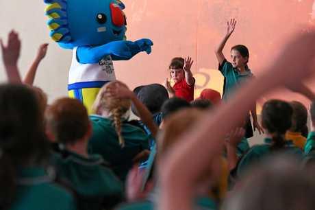 SWIMMING: Borobi, Zoe Vuichoud and Liliana Brillante on stage at the St Joseph's Catholic Primary School.