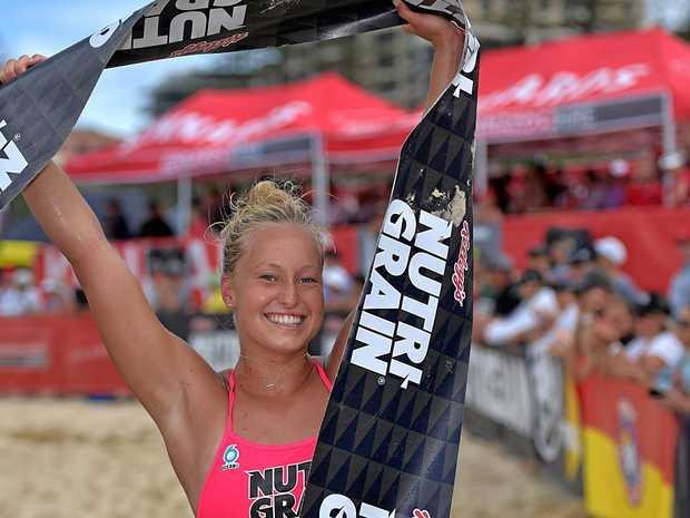 WINNER: Brielle Cooper crosses the line in the women's race.