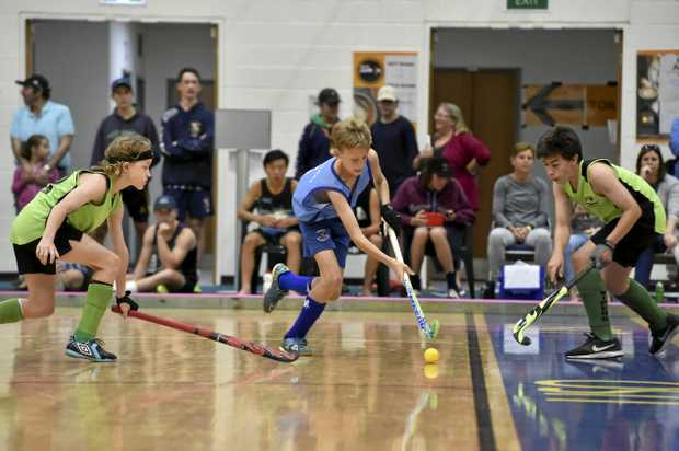 ON THE FLOOR: Toowoomba's Matthew Wallace takes on the defence during his side's Queensland under-15 boys indoor hockey state title match.