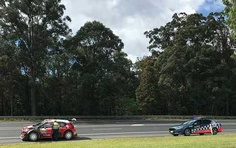 Police stop a WRC Rally driver in Coffs Harbour to talk about traffic matters.