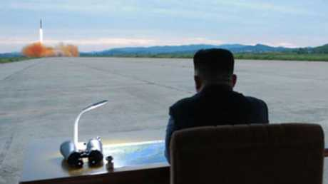 This picture released by North Korea shows Kim Jong-un during a Hwasong-12 IRBM launch. Picture: KCNA