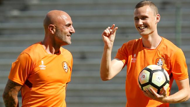 Daniel Bowles (right) gestures to teammate Massimo Maccarone.