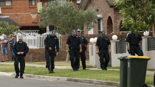 Police search the area around the Ibrahim brothers mother's home at 16 Price St, Merrylands, where Tongan Sam was shot. Picture: Steve Tyson