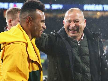 Eddie Jones shares a joke with Will Genia after the game at Twickenham.