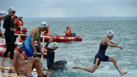 Alison Green enters the water. The first-ever Barge2Beach ocean swim, held on Hog's Hervey Bay 100 weekend.