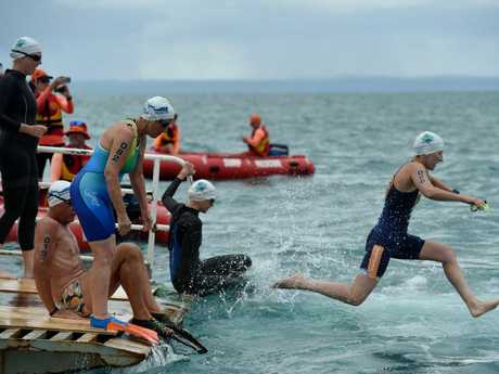 Alison Green enters the water. The first-ever Barge2Beach ocean swim, held on Hog's Hervey Bay 100 weekend.