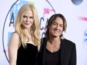 Nicole Kidman, left, and Keith Urban arrive at the American Music Awards at the Microsoft Theatre in Los Angeles.