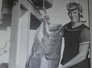 Spear fisher Noel Tregea about 50 years ago, pictured with some of his monster catches off the Keppels.