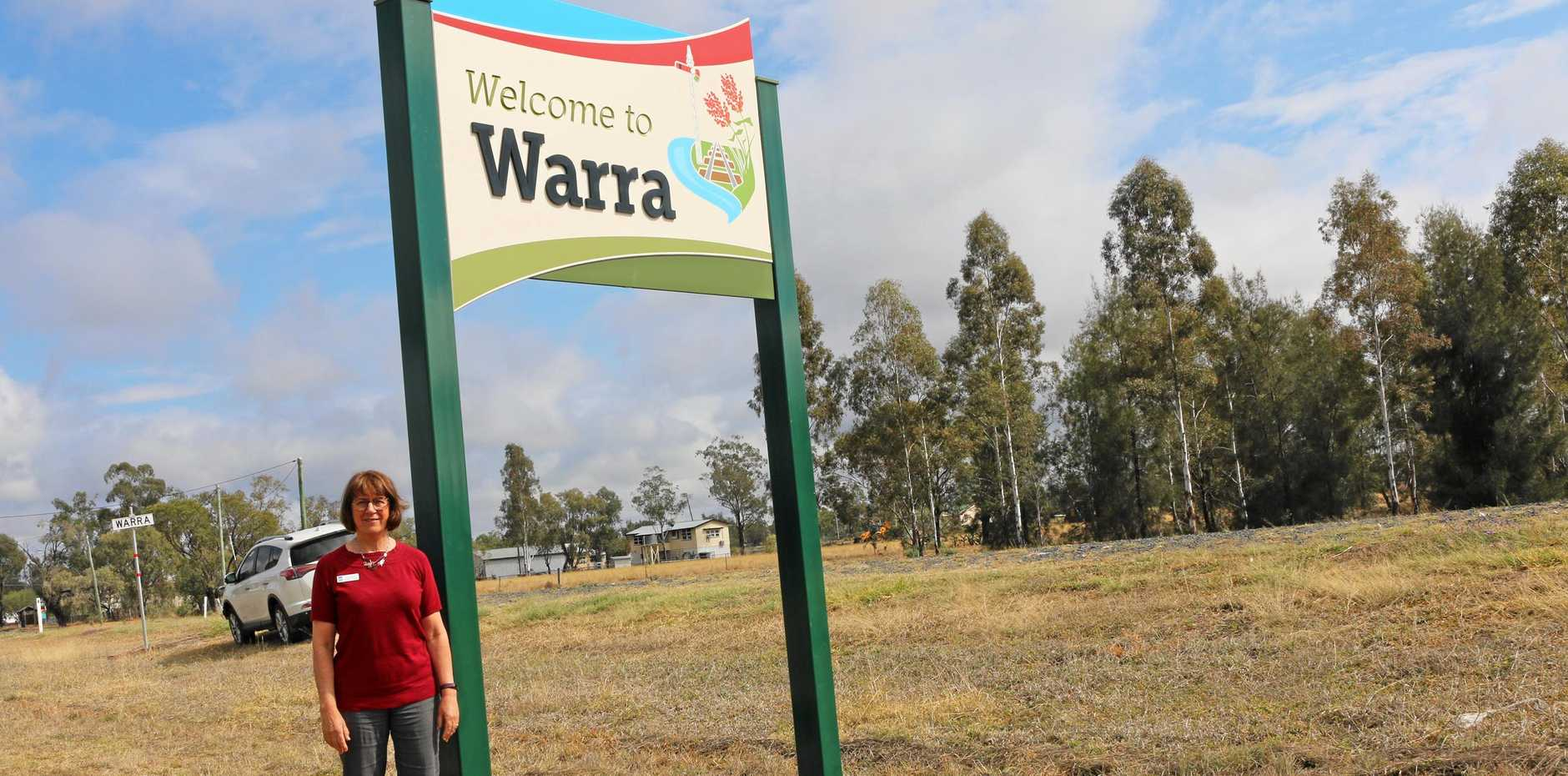 WELCOME: Carolyn Tillman is excited to see the new town entry sign standing tall and proud at Warra along the Warrego Highway.