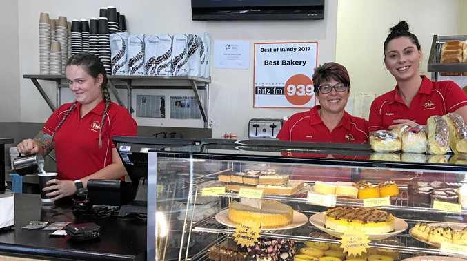 PIECE OF CAKE: Rise the Bakehouse's Ariel Morris makes a coffee as Jenny Grambower and Raylee Drescher welcome customers.