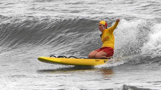 CHOPPY WATERS: Surf Lifesaver Dakoda Friske catches a wave at Nielson Beach in Bargara.