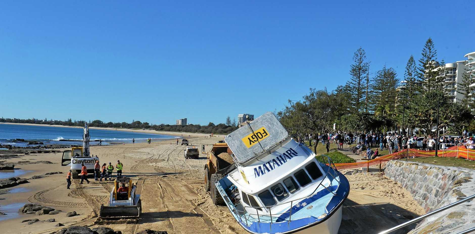 The Matahari being towed along Mooloolaba Beach.