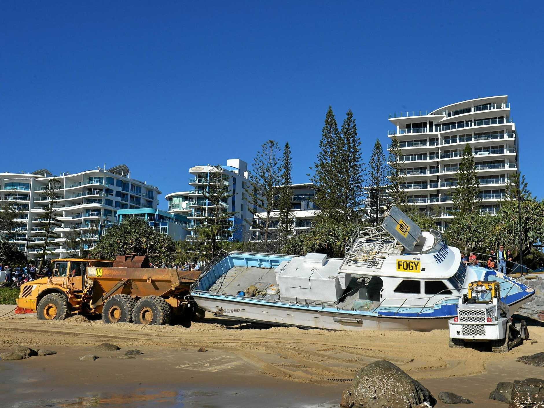 The Matahari being towed along Mooloolaba Beach.