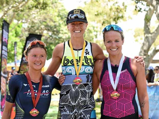 Open women's winner Meredith Hill (centre) with Els Visser (left) and Alise Selsmark.