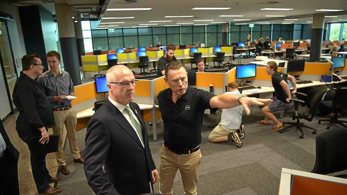 Youi boss Frank Costigan takes Mayor Mark Jamieson for a tour of the Sippy Downs headquarters.