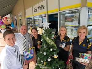 The Ray White team (from left) Damon Rootes, David Moppett, Kelly Mitchell, Ingrid Gardiner and Liz Donnan gathering presents for kids this Christmas.