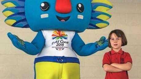 Gold Coast Commonwealth Games mascot Borobi with Mount Morgan Primary School student Harpa Hock.