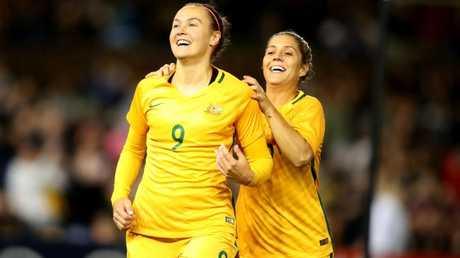 Caitlin Foord and Katrina Gorry celebrate a goal against Brazil.
