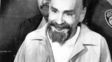 USA convicted murderer and cult leader Charles Manson in handcuffs in 1996.