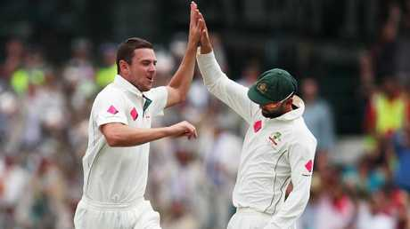 Josh Hazlewood celebrates a wicket with Nathan Lyon. Picture: Phil Hillyard