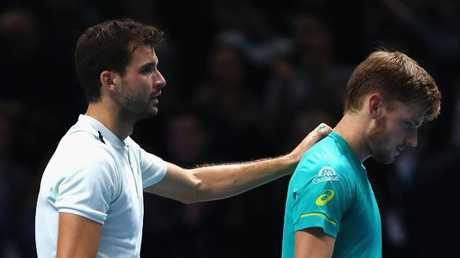 Grigor Dimitrov consoles David Goffin after the final.