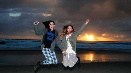 Annalise Doyle (left) and Sophie Rea from the Sunshine Coast made sure they were up for sunrise. Picture AAP/David Clark