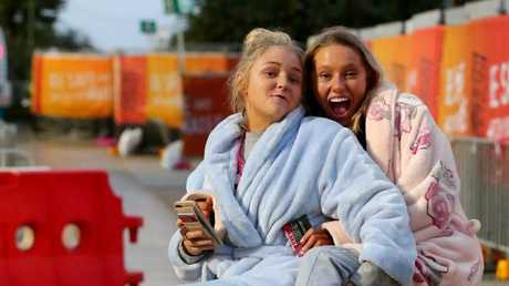 Shania Mills-Plowman (left) and Phoebe Bott from Brisbane made sure they were up for sunrise Picture AAP/David Clark