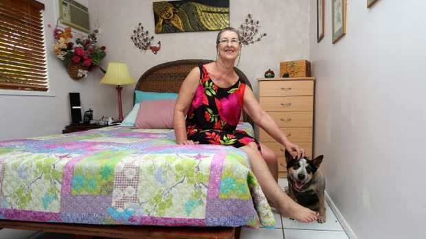 Susie the dog and Jan Nielson heard noises under her bed and discovered a 3m python in her bedroom at her Trinity Park home. PICTURE: STEWART McLEAN
