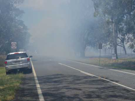 Smoke covered Warwick-Killarney Rd as a fire ripped through grass.