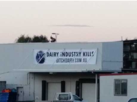 This large banner was hung on the roof of the slaughterhouse. It has now been pulled down by workers.