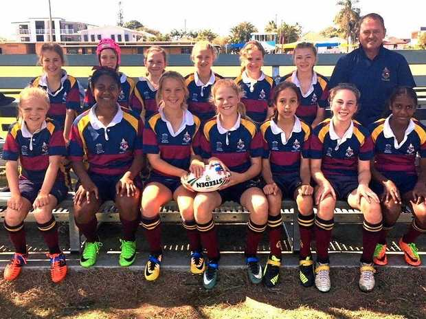 The TACAPS junior girls team (back, from left) Abbie Lane, Mehar Fegan, Mia Harvey, Zara Kruger, Bridget Bailey, Lily Kruger, Mr David Wigan (coach) and (front, from left) Millie Maclean, Rhema Oroge, Rosie Boyce, Alex Pearson, Annabelle Saunders, Holly Smith and Tamara Piva.