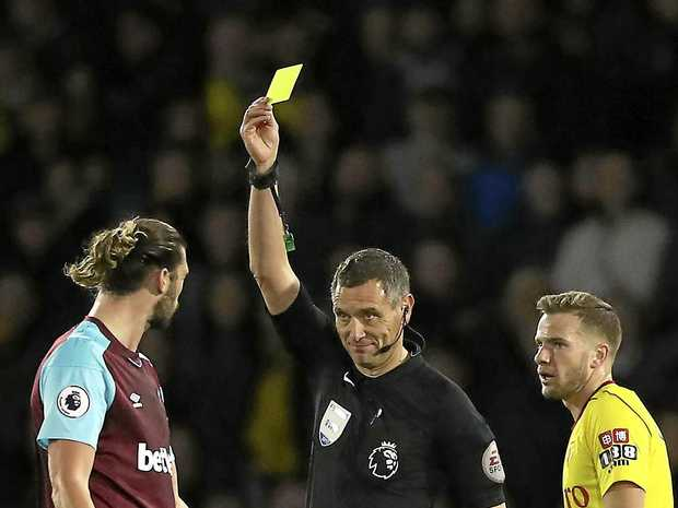 Nothing went right for West Ham in their loss to Watford on the weekend. Here referee Andre Marriner issues a yellow card to West Ham's Andy Carroll.