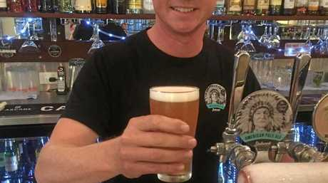 Palmwoods brewer Adam Tomlinson with his signature drop Sacred Chief.
