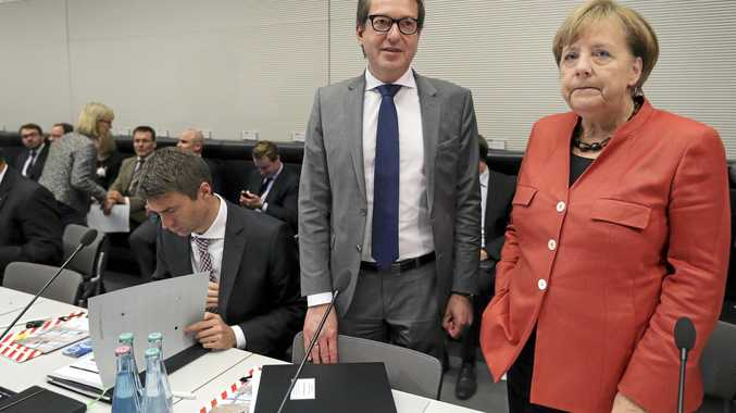 German Chancellor and chairwomen of the German Christian Democratic Party, Angela Merkel, right, and the chairman of the German Christian Social Union state group, Alexander Dobrindt arrive for a faction meeting at the German Federal Parliament, Bundestag.