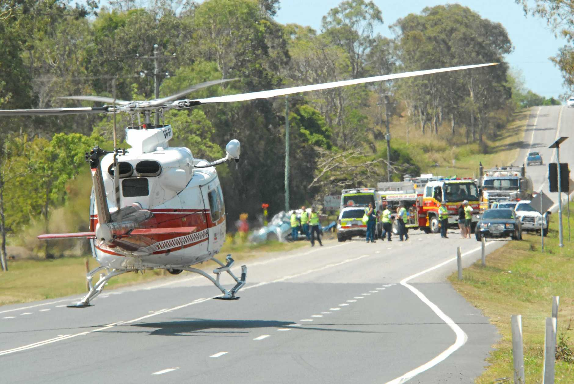 INQUEST: The RACQ CQ Rescue helicopter leaves the site of the fatal crash on the Peak Downs Highway at Greenmount, near Walkerston, on September 25, 2011.