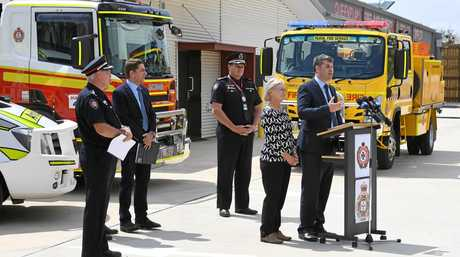 Minister for Fire and Emergency Services Mark Ryan presenting Burnett Heads Rural Fire Service with the keys to their new fire truck at the Queensland Fire and Emergency services Complex in Thabeban.