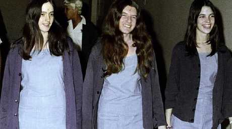 "Charles Manson followers, from left: Susan Atkins, Patricia Krenwinkel and Leslie Van Houten walk to court with ""x"" carved on to their foreheads. Picture: AP"