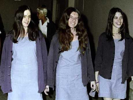 """Charles Manson followers, from left: Susan Atkins, Patricia Krenwinkel and Leslie Van Houten walk to court with """"x"""" carved on to their foreheads. Picture: AP"""