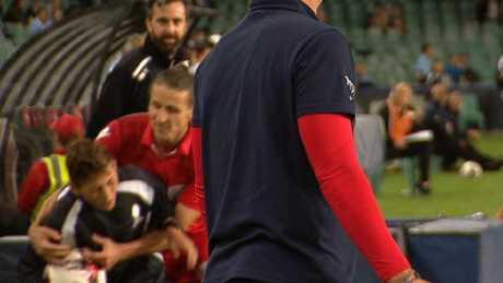 Michael Marrone tackles the ball boy.