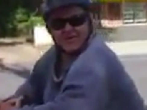 Man wearing terrible bike pants taunts woman on the street.