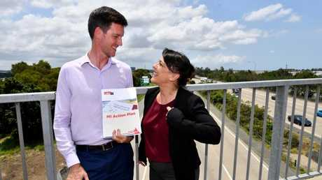 Queensland Minister for Energy, Biofuels and Water Supply, Mark Bailey (left) says Labor helped to stabilise power bills. (AAP Image/Darren England)