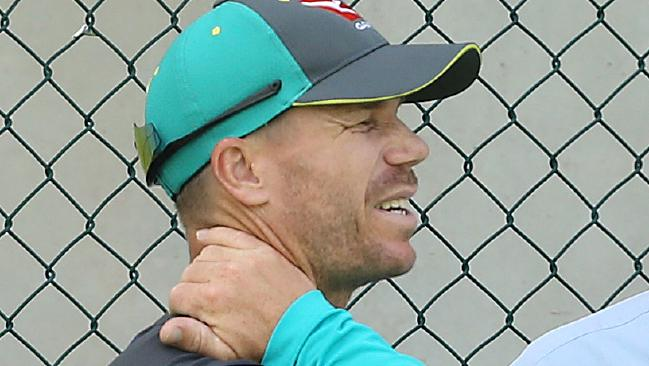 In pain ... David Warner at practice today. Photo: AAP