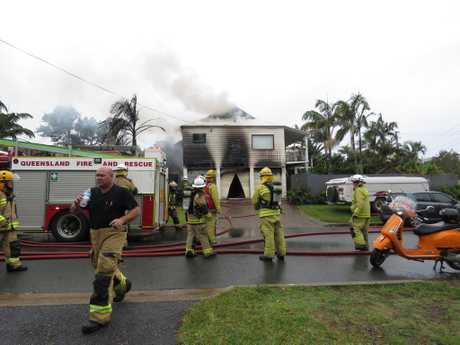 A Sunshine Beach home and three caravans were destroyed in a blaze on Wednesday.