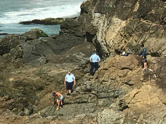A man has fallen 10m down a cliff onto rocks at a Byron Bay beach this afternoon.