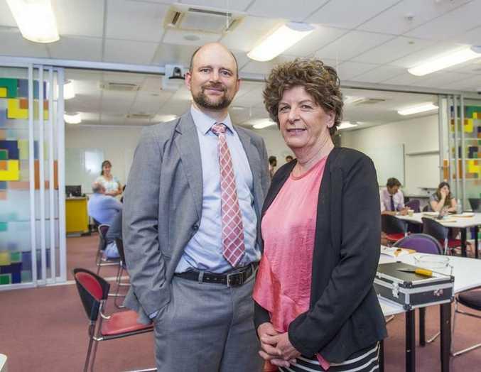 USQ Associate Professor Linda Galligan with the Reserve Bank's Dr Leon Berkelmans.