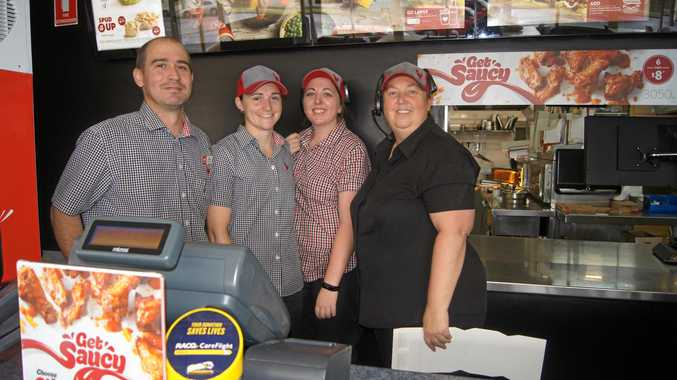 READY TO SERVE: Red Rooster operations manager for Stanthorpe and Warwick Robert Condrick, assistant manager Alana Condrick, cashier Alannah Drayton and restaurant manager Nicole Peake.