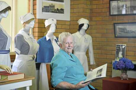 Sister Anthea Groves, the hospital administrator from 1977-87, admires the historical display as St Vincent's Private Hospital celebrates 95 years of service, Tuesday, November 21, 2017.