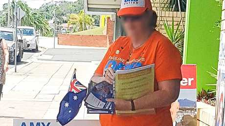 One Nation volunteers caught handing out LNP how to vote cards.
